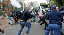Protesters and S.African police clash at Zimbabwe embassy