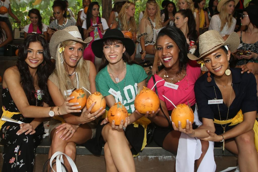 Miss Scotland, Jamey Bowers; Miss Belgium, Naomie Happart; Miss Austria, Ena Kadic (3rd left); Miss Ethiopia, Genet Tsegay Tesfay; and Miss South Africa, Marylin Ramos pose during a visit of the Miss World contestants in Bali on September 13, 2013