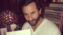 Cuteness Alert! This picture of daddy Saif holding baby Taimur's sketch is heartwarming