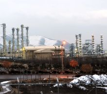 Iran builds pressure, sets date to surpass uranium stockpile limit