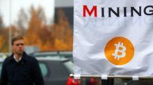 Cryptos Lower, Bitcoin Falls From Three-Week High
