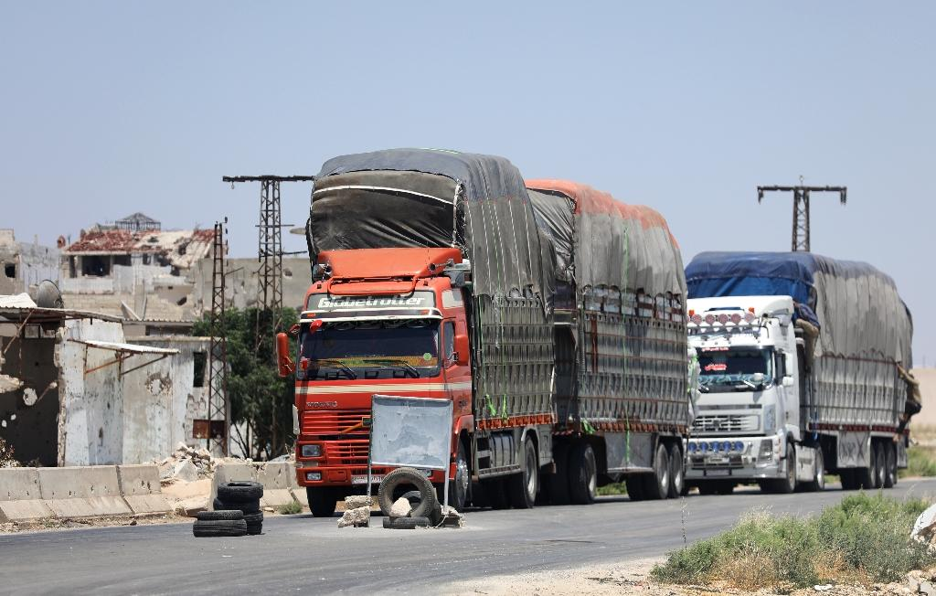 Year round, vegetables, biscuits and clothes leave Idlib, while fuel, sugar, and spare car parts are trucked in through Hama (AFP Photo/OMAR HAJ KADOUR)