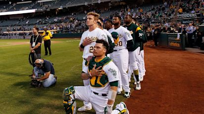 A's fans cheer player who knelt during anthem