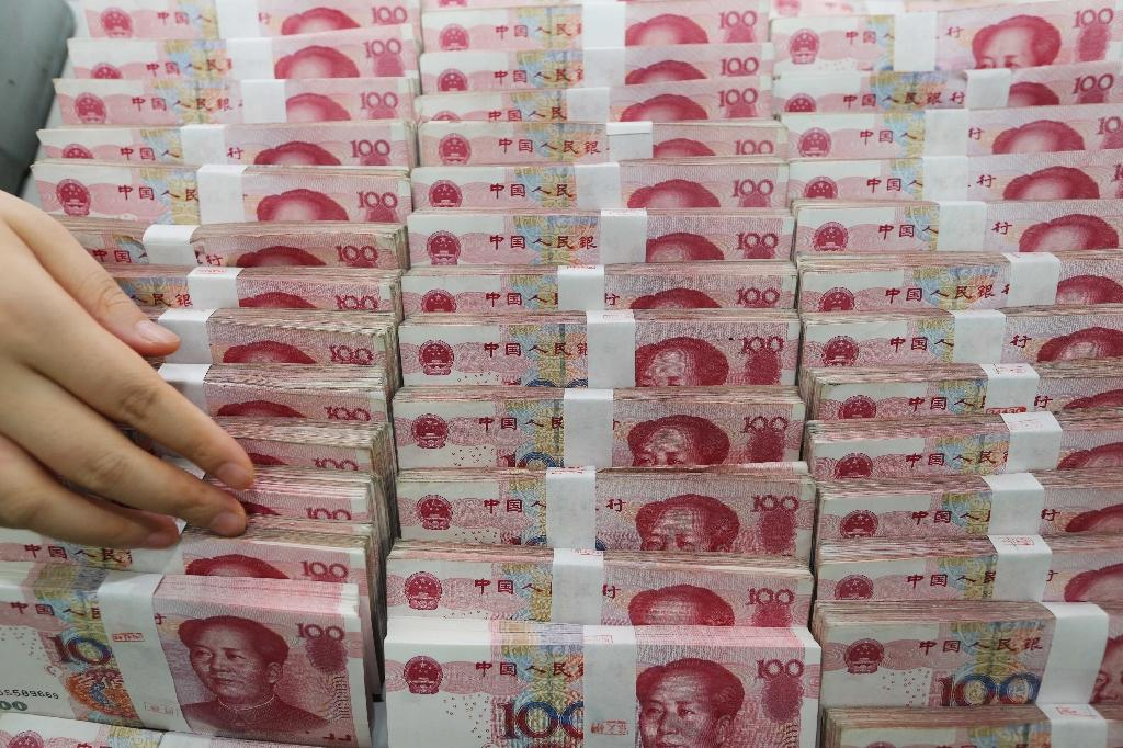 China will double the deposit required for investors to borrow funds to trade stocks –- known as margin trading (AFP Photo/)