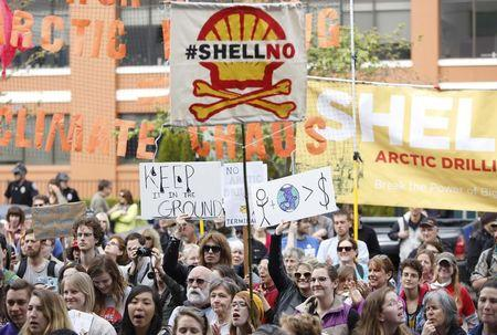 Activists protest the Shell Polar Pioneer oil rig at a rally in Seattle, Washington