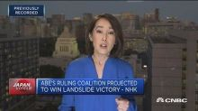 Abe's ruling coalition projected to win landslide victory...