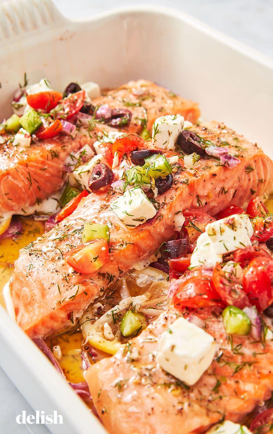 "<p>Extra veggies and feta, please!</p><p>Get the recipe from <a href=""https://www.delish.com/cooking/recipe-ideas/a26103199/greek-salmon-recipe/"" rel=""nofollow noopener"" target=""_blank"" data-ylk=""slk:Delish"" class=""link rapid-noclick-resp"">Delish</a>.</p>"
