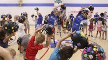 UnitedHealthcare Pro Cycling Team Donates Helmets to Denver YMCA