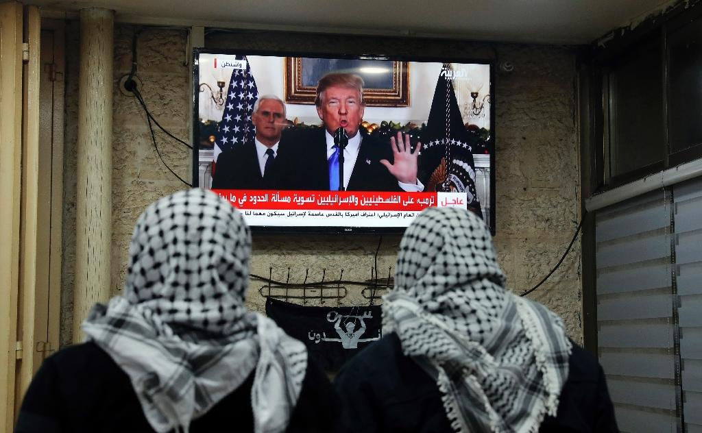 Palestinian men watching President Donald Trump's address recognizing Jerusalem as Israel's capital on December 6