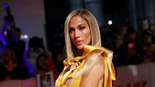 J.Lo sizzles in yellow dress and crystal-covered clutch at Toronto Film Festival