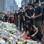 Flowers pile up for dead Hong Kong protester