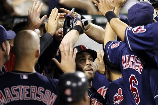 Cleveland Indians' Jason Kipnis, center, celebrates in the dugout after hitting a three-run home run off Chicago White Sox starting pitcher John Danks during the seventh inning of a baseball game, Thursday, May 3, 2012, in Chicago. (AP Photo/Charles Rex Arbogast)
