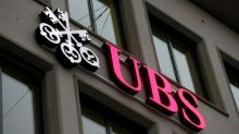 UBS tightens investment banking belt as earnings slide continues