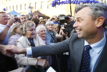Austrian far right Freedom Party's (FPOe) presidential candidate Norbert Hofer (R) shakes hands with supporters during his final election rally in Vienna, Austria, May 20, 2016. REUTERS/Leonhard Foeger