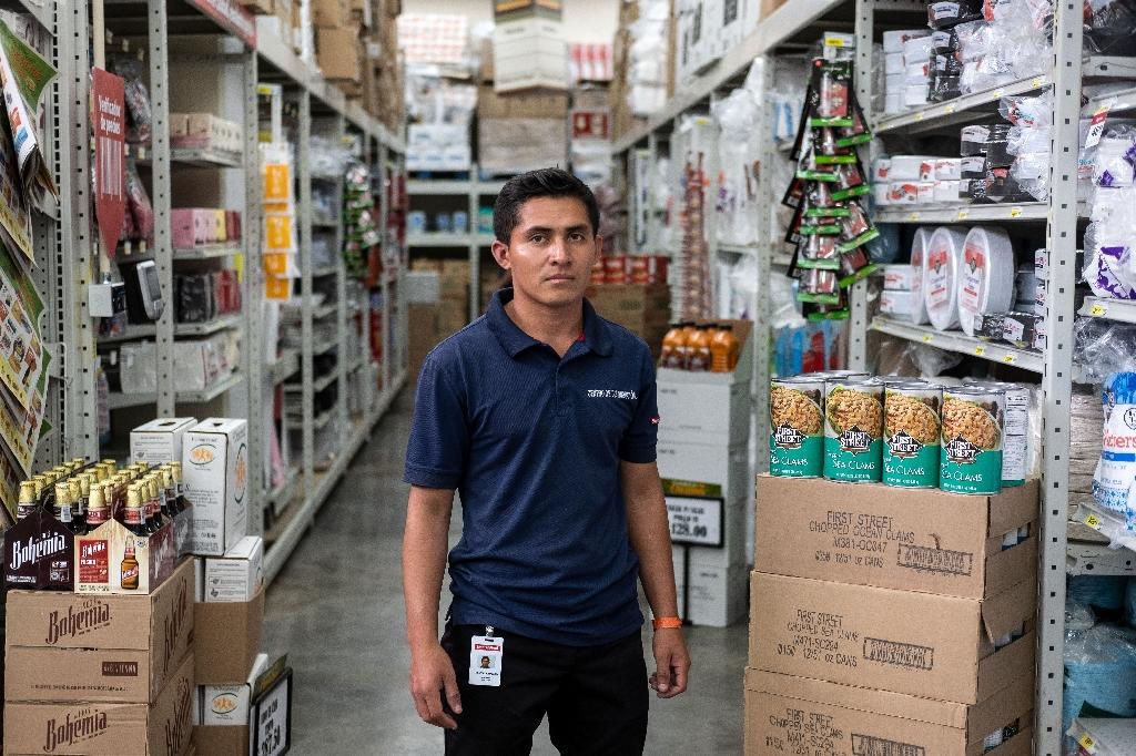 Denny Guevara, 26, has found work at a supermarket in Mexico; his next dream is to make enough money to send for the wife and three children he left behind in Honduras (AFP Photo/Guillermo Arias)