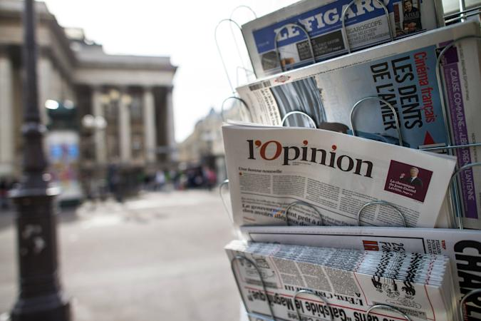 """A copy of the newspaper """"L'opinion"""" is pictured in a newsstand on May 15, 2013 in Paris. The newspaper, also available online, was released on May 15, 2013 in France. AFP PHOTO/FRED DUFOUR        (Photo credit should read FRED DUFOUR/AFP via Getty Images)"""
