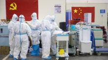 Senior Wuhan doctor dies from coronavirus as authorities start to 'round up' patients