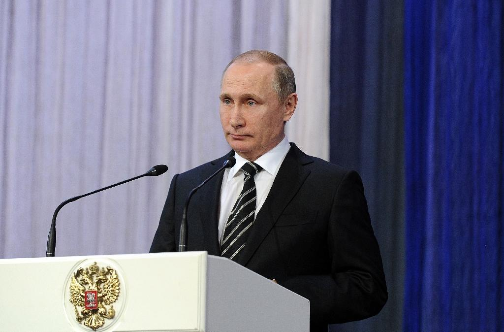 """Russia's President Vladimir Putin, pictured on February 20, 2016, said Russia will do """"whatever is necessary"""" to ensure that Damascus respects a Syrian ceasefire agreement"""