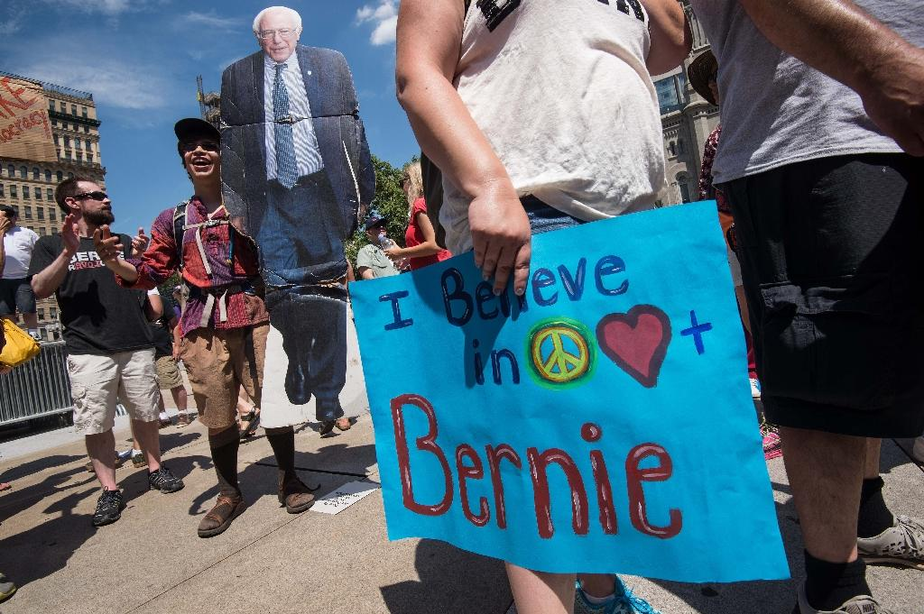 A supporter of Bernie Sanders holds a cardboard cutout of the former US Democratic presidential candidate in Philadelphia on July 24, 2016 (AFP Photo/Nicholas Kamm)