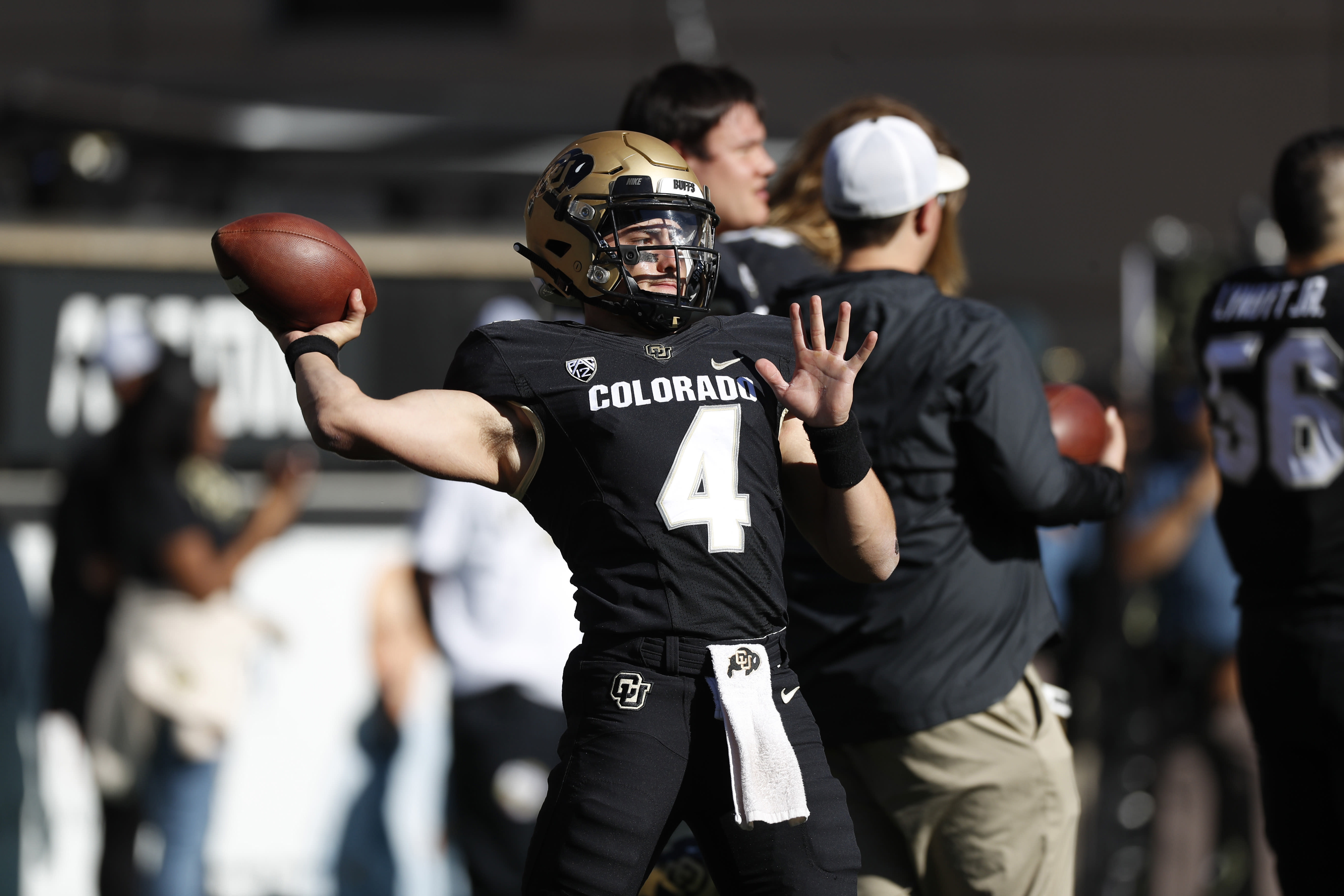 FILE—Colorado quarterback Sam Noyer warms up before an NCAA college football game Saturday, Nov. 9, 2019, in Boulder, Colo. Noyer, who left the university in search of a chance to quarterback a team, has returned to Colorado to vie for the first-string play caller position after a call from the university's new football coaching staff. (AP Photo/David Zalubowski, File)