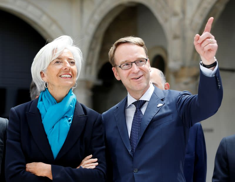 FILE PHOTO: International Monetary Fund (IMF) Managing Director Lagarde listens to German Bundesbank President Weidmann as they pose for a family picture in Palace Chapel during the G7 finance ministers and central bankers meeting in Dresden