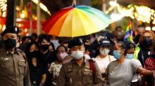 Thai LGBT activists raise pride flag in anti-government rally