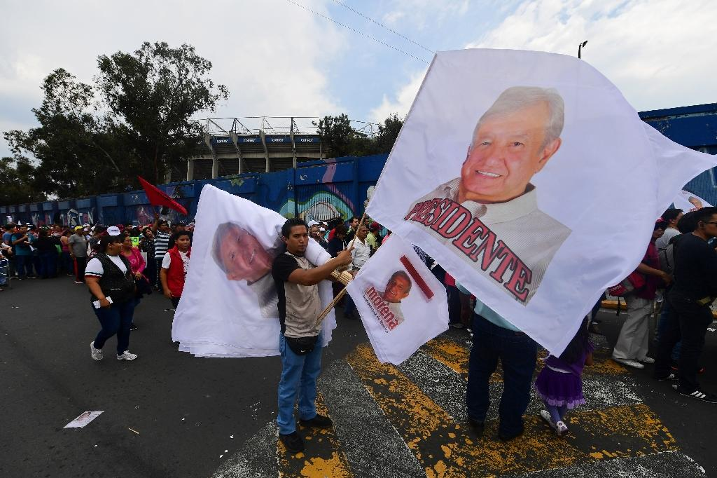 Supporters of Mexican presidential candidate Andres Manuel Lopez Obrador arrive for their candidate's closing campaign rally at the Azteca stadium in Mexico City (AFP Photo/PEDRO PARDO)