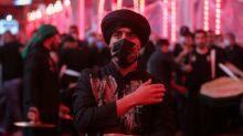 Masks and tears: Shiites mark Ashura at Iraq shrines despite virus