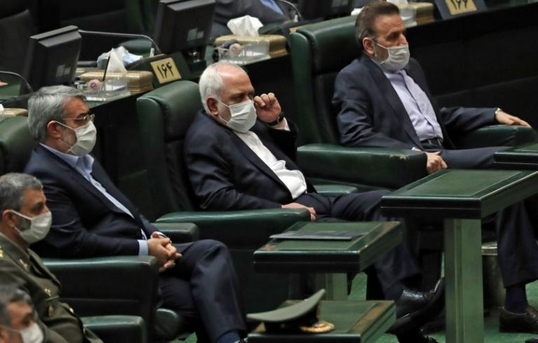 Iranian Foreign Minister Mohmmad Javad Zarif (enter) attends the opening of a parliamentary session in May 2020 (AFP Photo/-)