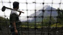 Philippine volcano spews lava; thousands flee