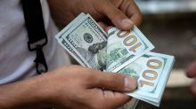 Dollar dips on trade optimism, before Fed meeting