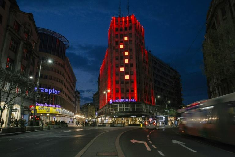 One building in Belgrade was lit up in the colours of the Chinese flag (AFP Photo/Vladimir Zivojinovic)