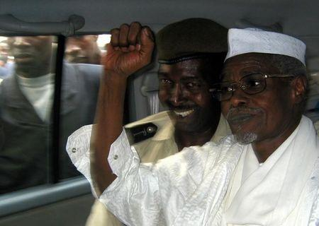 Former Chad President Habre raises his fist in air as he leaves court in Dakar, Senegal
