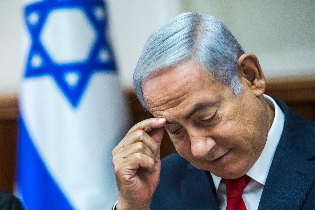 Israeli Prime Minister Benjamin Netanyahu has defended allowing Qatar to send millions of dollars to the Hamas-run Gaza Strip despite criticism from within his government (AFP Photo/JIM HOLLANDER)