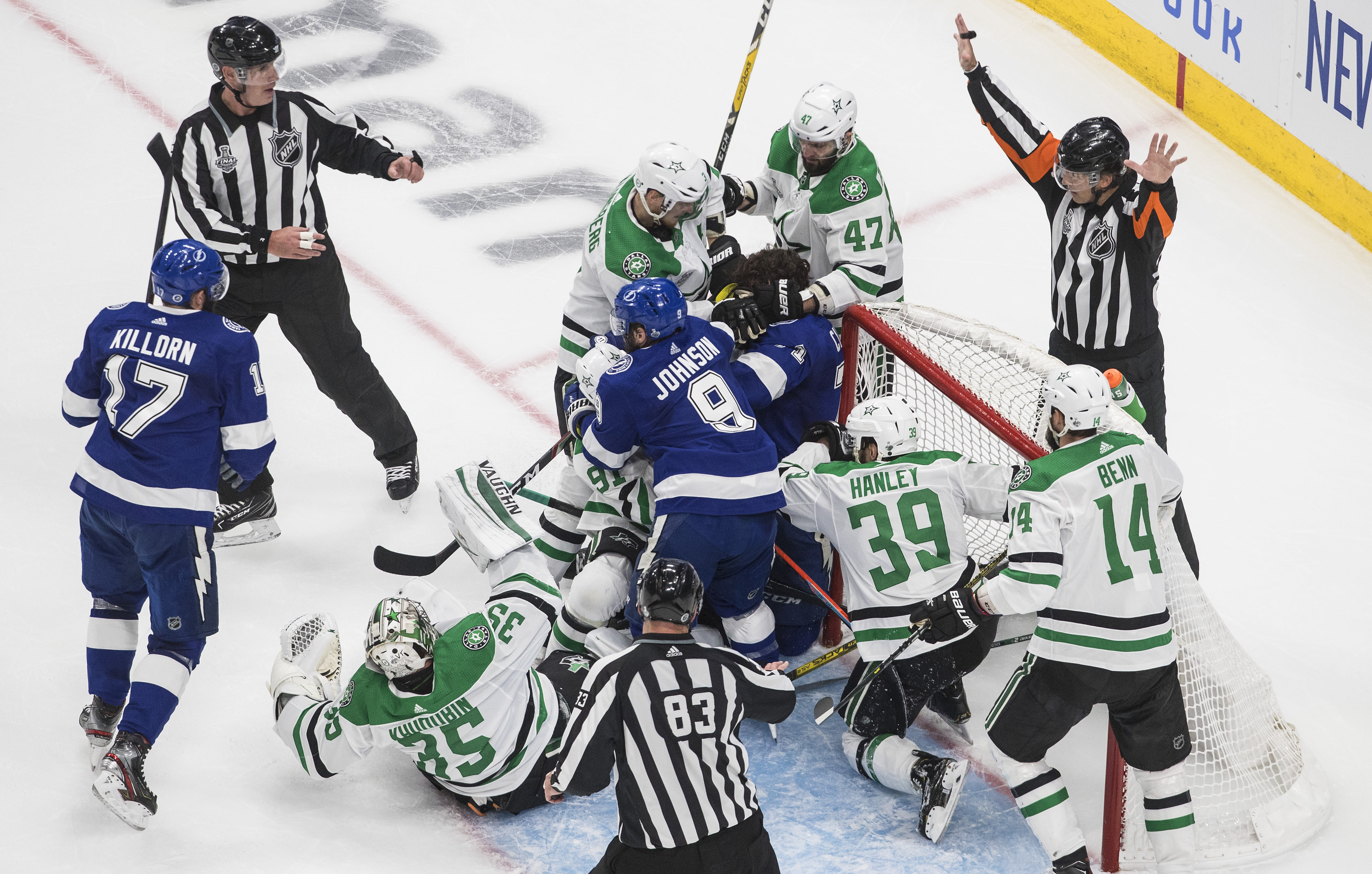 The referee stops play as the Dallas Stars and the Tampa Bay Lightning battle in the crease during second-period NHL Stanley Cup finals hockey action in Edmonton, Alberta, Saturday, Sept. 19, 2020. (Jason Franson/The Canadian Press via AP)