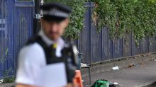 Police launch manhunt after woman is stabbed several times in the back on London street