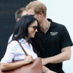 Prince Harry and Meghan Markle hold hands at first official joint appearance