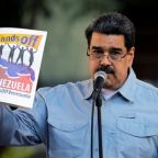 U.S. raises pressure on Maduro via sanctions, aid airlift