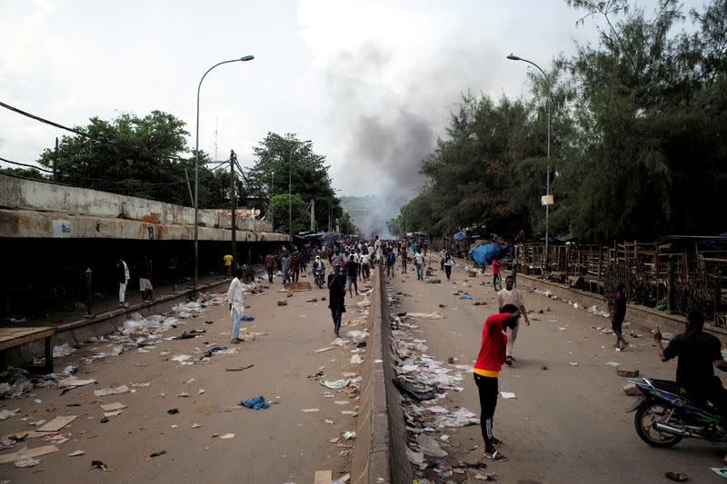 Smoke rises supporters of Imam Mahmoud Dicko and other opposition political parties protest against President Ibrahim Boubacar Keita in Bamako
