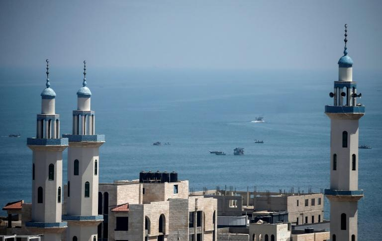 Palestinian fishermen take to the Mediterranean sea off Gaza City