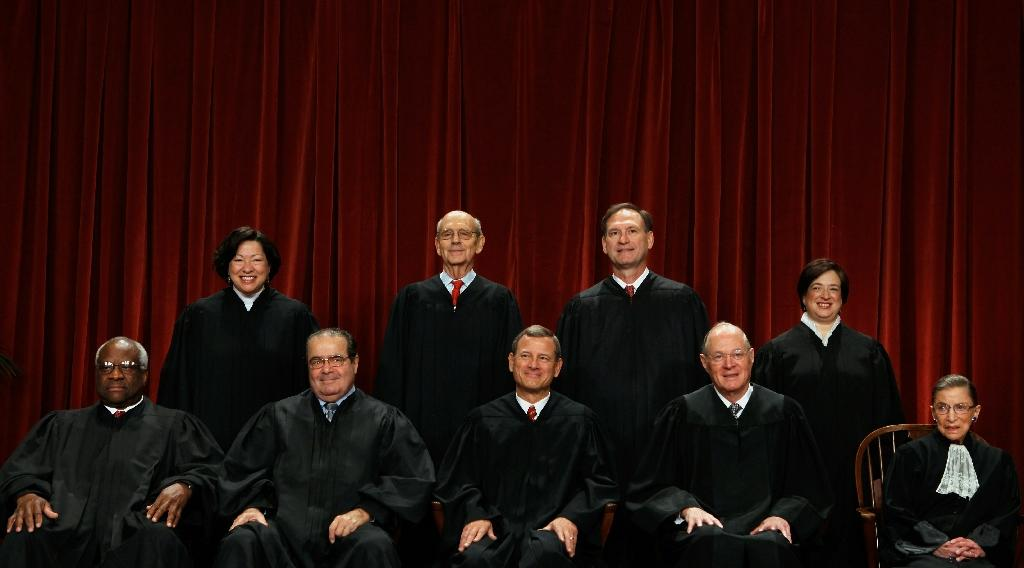 US Supreme Court Justices (first row L-R) Clarence Thomas, Antonin Scalia, John Roberts, Anthony Kennedy, Ruth Bader Ginsburg, (back row L-R) Sonia Sotomayor, Stephen Breyer, Samuel Alito and Elena Kagan on October 8, 2010 (AFP Photo/Chip Somodevilla)