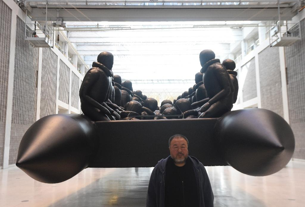 "Chinese conceptual artist Ai Weiwei says his artwork ""The Law of the Journey"" portrays the risks that refugees face in their trek to Europe (AFP Photo/Michal Cizek)"