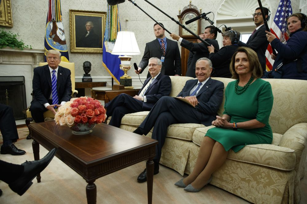 President Donald Trump meets with, from left, Senate Majority Leader Mitch McConnell, R-Ky., Senate Minority Leader Chuck Schumer, D-N.Y., and House Minority Leader Nancy Pelosi, D-Calif., and other Congressional leaders in the Oval Office of the White House, Wednesday, Sept. 6, 2017, in Washington. (AP Photo/Evan Vucci)