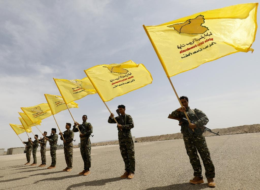 Fighters of the Syrian Democratic Forces, trained by the US-led coalition, take part in a graduation ceremony in the suburbs of the eastern city of Deir Ezzor, on May 21, 2018
