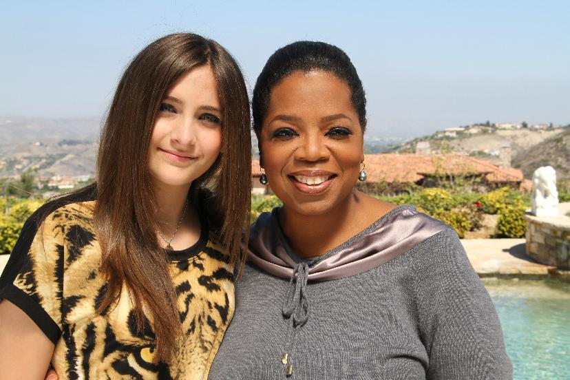"""FILE - This undated image originally released by Harpo, Inc. shows host Oprah Winfrey posing with Paris Jackson, daughter of the late pop icon Michael Jackson in Los Angeles. Winfrey interviewed Jackson for an """"Oprah's Next Chapter,"""" special which aired on June 10 on OWN. (AP Photo/Harpo Inc., George Burns)"""