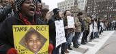 Protesters hold signs up for Tamir Rice. (AP)