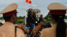 Father and son jailed over bomb blast at Vietnam police station
