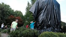 Charlottesville shrouds divisive Confederate statues in black cloth