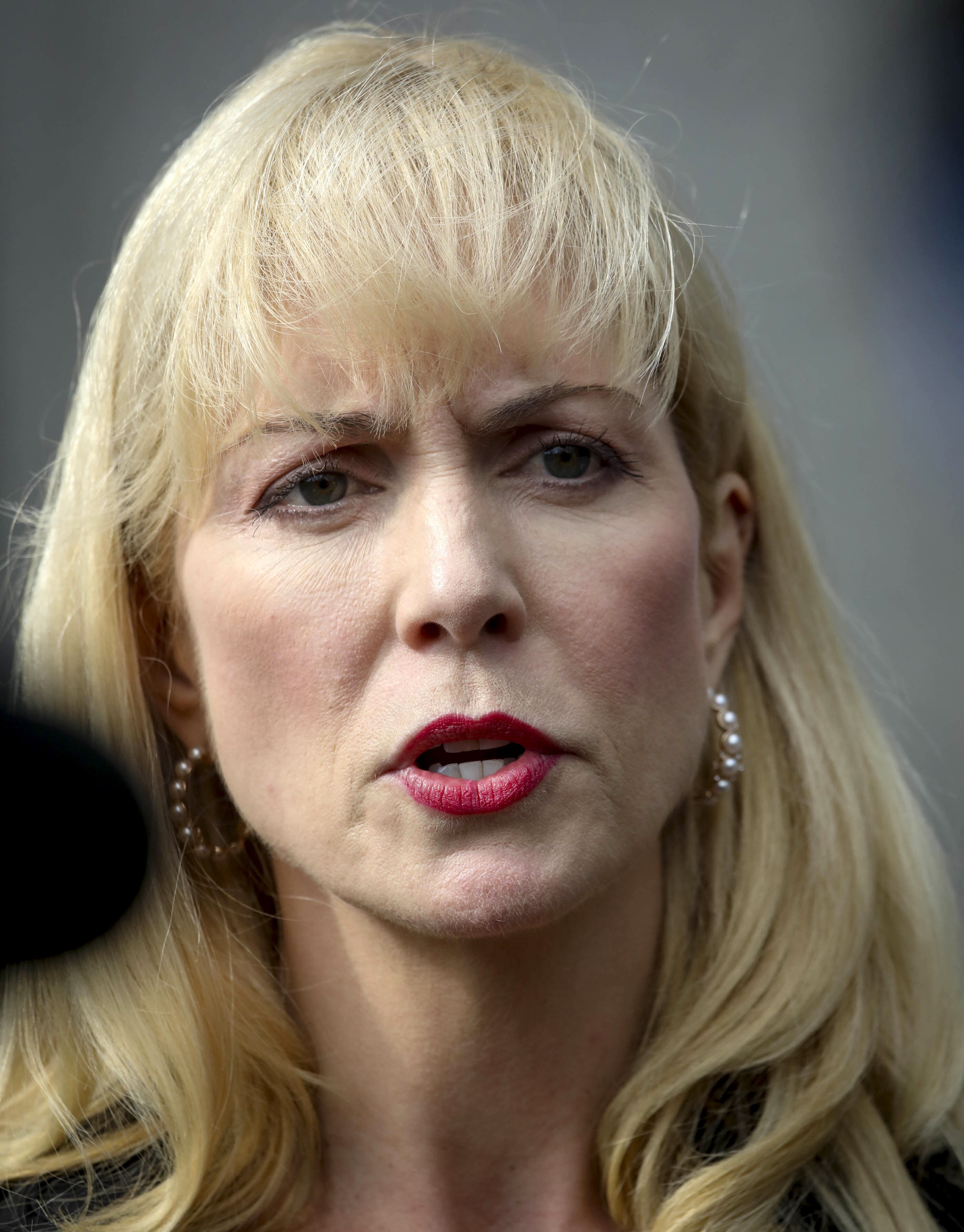 Sigrid McCawley, attorney for alleged sexual abuse victims of financier Jeffrey Epstein who committed suicide while awaiting trial, addresses media after a hearing in Manhattan Federal Court to discuss plans for unsealing more court records for a civil case against Epstein, Wednesday Sept. 4, 2019, in New York. (AP Photo/Bebeto Matthews)