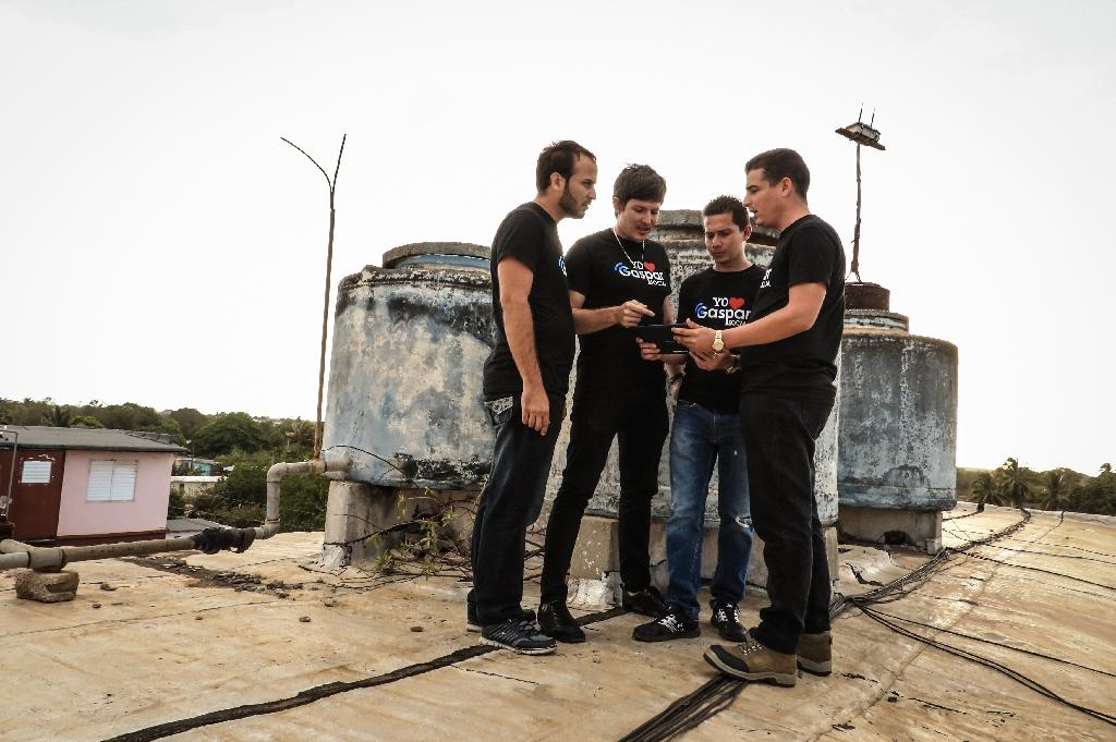 The four creators of the Gaspar Social network in Cuba hope that it will lead the rest of the communist island to greater connectivity (AFP Photo/ADALBERTO ROQUE)